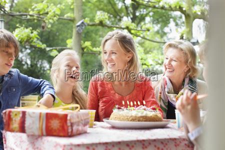 girl making birthday wish with her