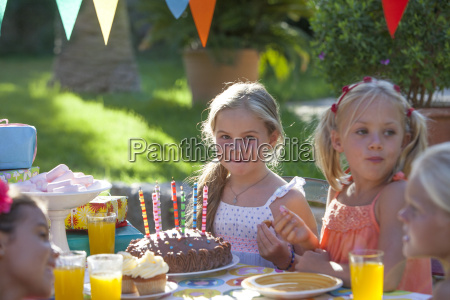 girl sitting at table with birthday