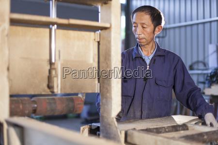 carpenter working on wood flooring in