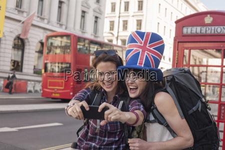 two women backpackers wearing union jack