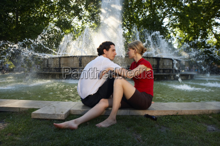 couple by fountain