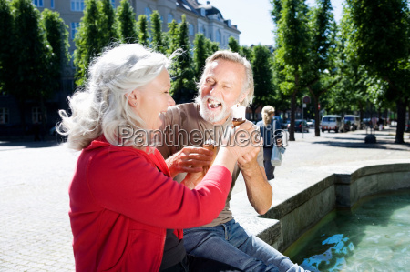 couple with ice cream laughing