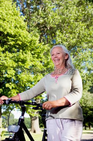mature woman with bike