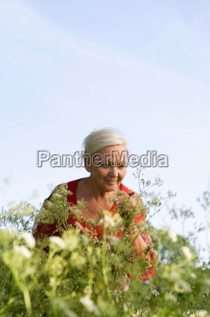 portrait of mature woman with flowers