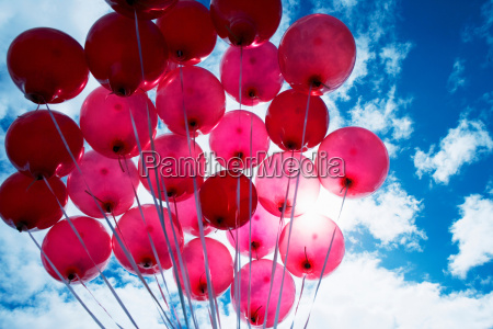 red balloons against blue sky