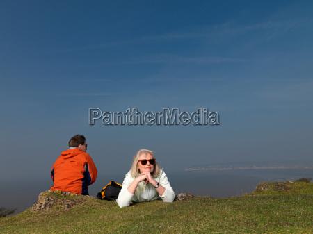 man woman resting on hike