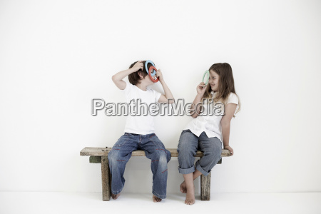 young boy and girl smiling at