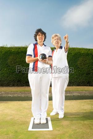 female bowlers discussing tactics