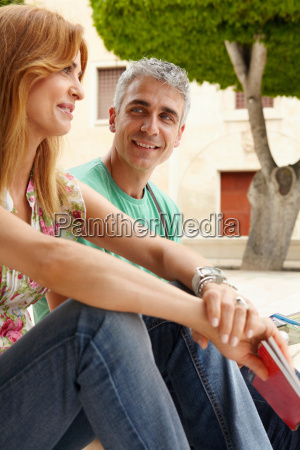 tourist couple in city street