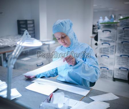 female scientist in laboratory clean room