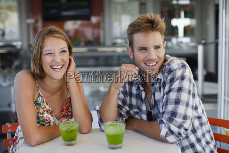 couple having drinks at cafe
