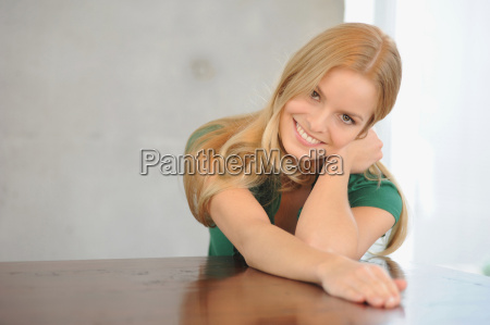 smiling woman sitting at table