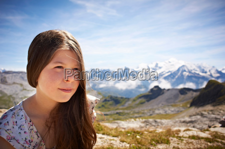 girl standing in rocky landscape