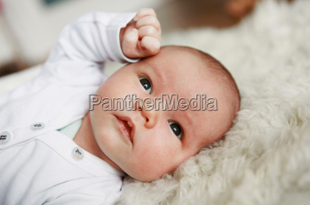 close up of infant laying on