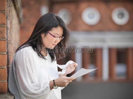 student receiving unsuccessful exam results at