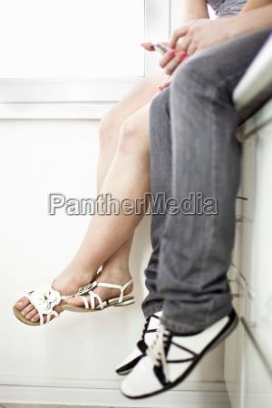 teenage couples dangling feet