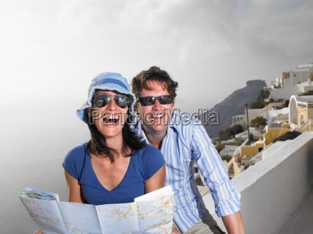 couple looking at a map laughing