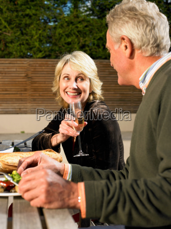 senior couple eating meal outdoors