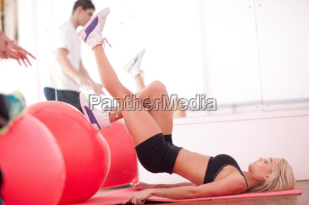 young woman on gym floor training