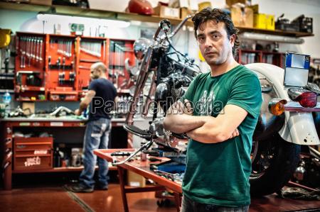 portrait of male mechanic in motorcycle
