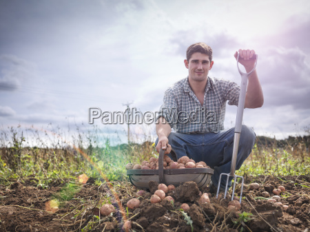 portrait of farmer with basket of