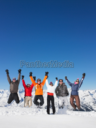 group jumping in snow