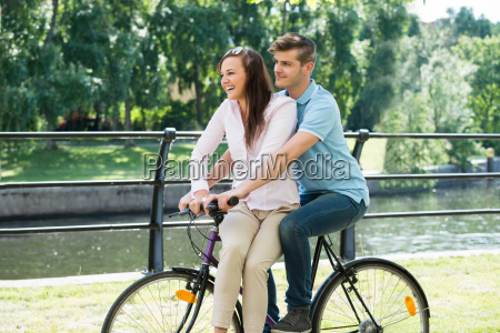 the happy couple on bicycle in