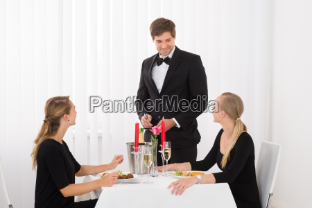 waiter taking an order from female