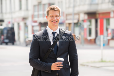 young businessman walking on street