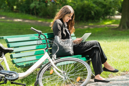 smiling young businesswoman using digital tablet
