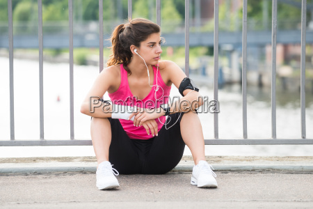 contemplated fitness woman listening to music