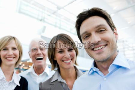 4 happy people looking at viewer