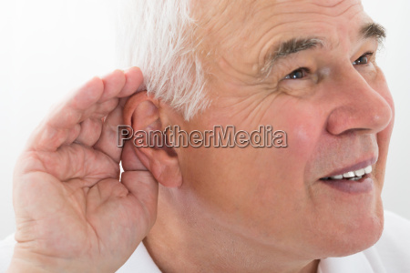 senior man trying to hear