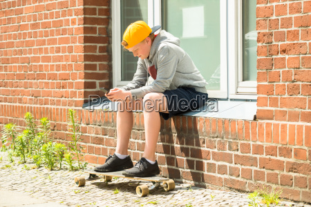 boy with skateboard using at his