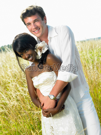 married couple in a field