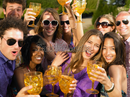 people toasting their glasses