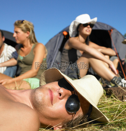 people in a field backpacking