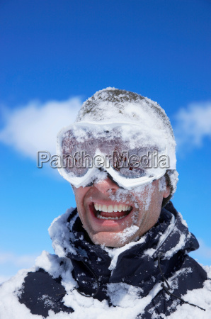 man laughing face covered with