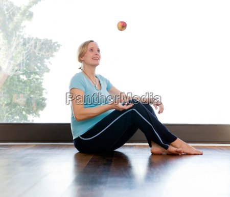 pregnant woman juggling apple