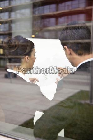 business people looking at paperwork