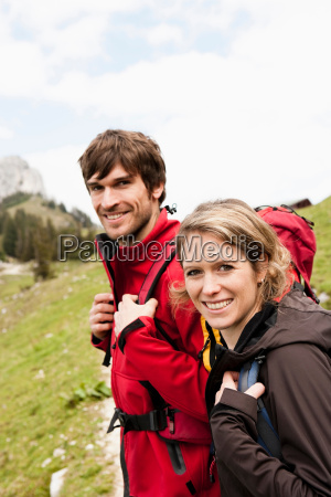 hiking couple looking to camera