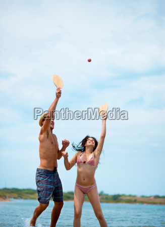 couple playing beach ball at the