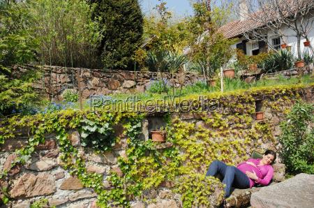 pregnant woman relaxing in spring garden
