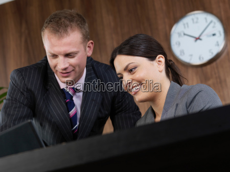 business man and woman at desk