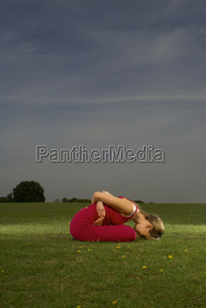 woman doing yoga in park