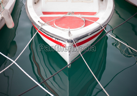 small boat moored in harbour