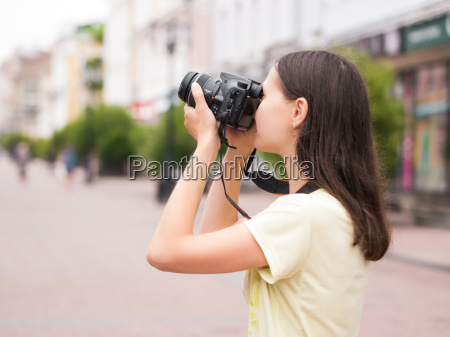 cheerful young woman watching shots on