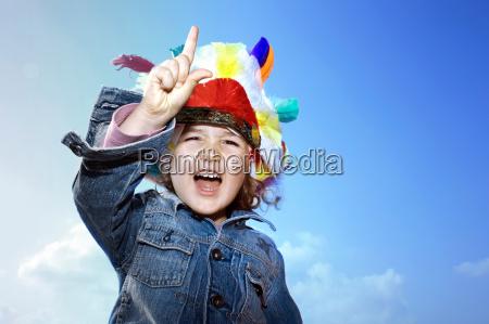 toddler girl wearing indian headdress