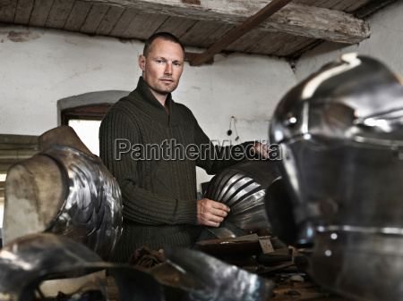 blacksmith crafting armor in shop