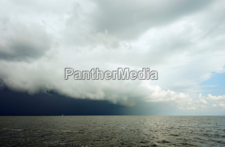 clouds looming over ocean